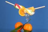 Two fruit juice ice in vase on blue background