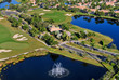 aerial view of entrance to nice florida golf community - 48078662