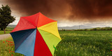 Tuscany Countryside with Storm and colorful Umbrella