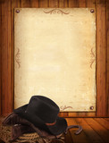 Western background with cowboy clothes and old paper for text