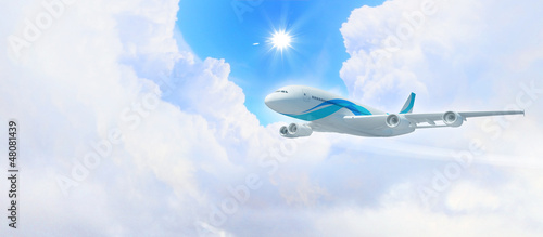 White passenger plane in the blue sky