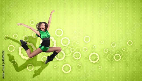 young woman dancing and jumping...