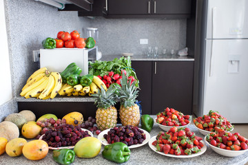 abundance of fruits and vegetables in the kitchen