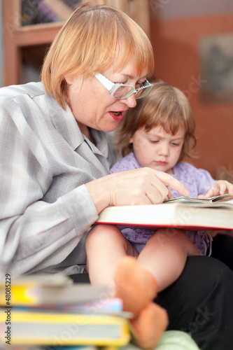 grandmother and child reads  book