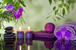 Zen stones orchid aromatic candles and towel spa concept