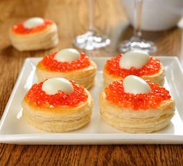 vol-au-vent with red caviar and quail eggs