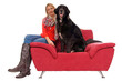 Young woman with her dog on a couch