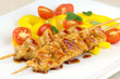 Glazed turkey breast skewers with bell pepper and tomato salad