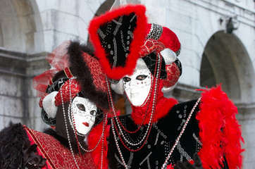 Person in Venetian costume attends Carnival of Venice.