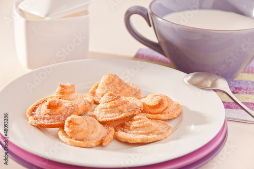 Homemade puff pastry cookies with milk