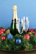 Beautiful Christmas wreath in composition with champagne