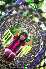 Asian little girl enjoys playing in a children playground, Outdo