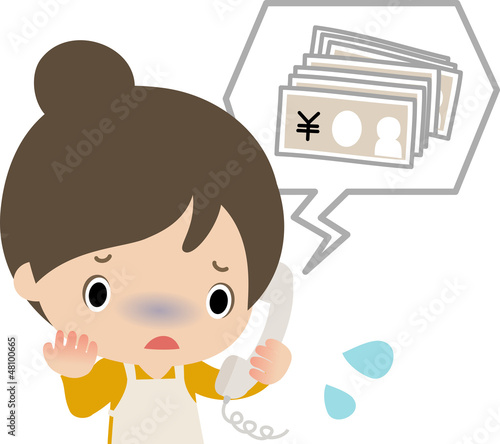 お金を要求する電話に動揺する主婦