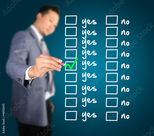 Business man designed yes or no checklist