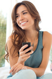 Woman Smiling And Holding Cell Phone