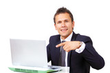 Handsome businessman pointing to computer