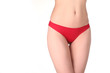 A part of woman body in red panties