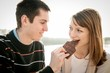 Young couple in locve eating chocolate