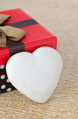 cookie with icing in the form of heart near the gift box