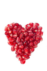 pomegranate seeds in heart shape isolated