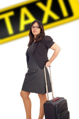 Business woman with suitcase and taxi sign