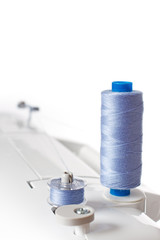 thread spools on the sewing machine on a white background