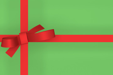 Red gift ribbon bow on green background