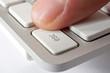 Finger pressing ESC key