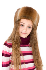 The girl in a winter fur-cap