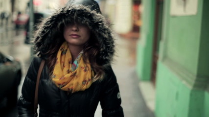Pensive young woman walking in the city, steadicam shot