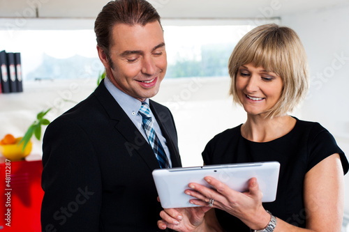 Female secretary showing appointments to boss
