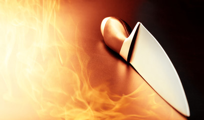 Professional knife on kitchen fire