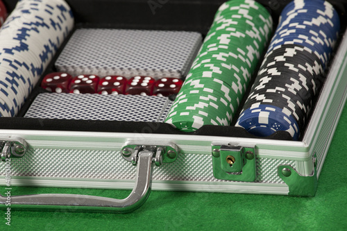 A photo of poker chips and cards in a briefcase