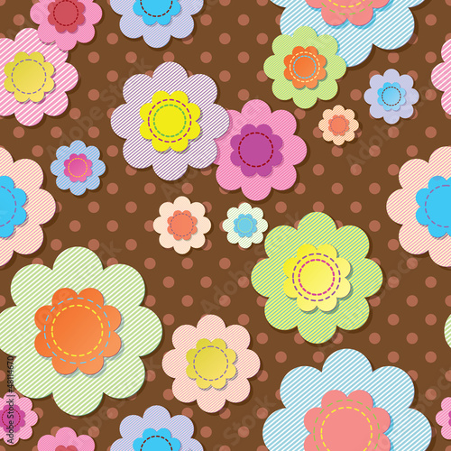 Seamless textile flowers on brown polka dot fabric