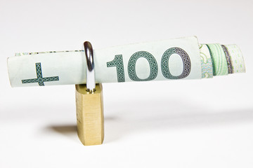 Kłódka z banknotem 100 złoty