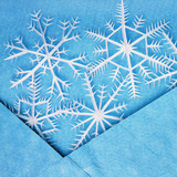White snowflakes in the blue envelope