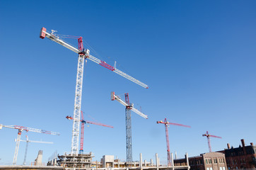 Cranes  on top of new condo construction