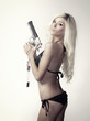 Beautiful blond woman with gun