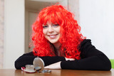 Smiling woman in red wig
