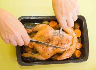 baked chicken on roasting pan