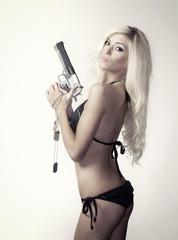 Beautiful blond woman with gun