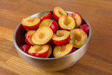 Bowl of halfed plums