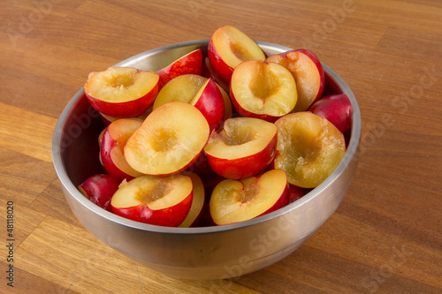 Bowl of halfed plums