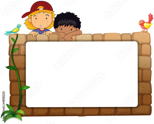 Kids with white board on wall