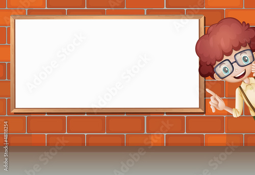 A boy showing white board