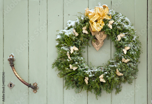 Green Christmas wreath on a wooden door