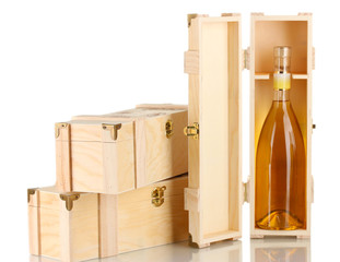 Wine bottle in wooden box, isolated on white