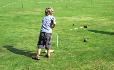 boy playing Croquet. goal/ achievement