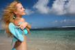 Beautiful girl suntanning by the beach
