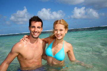 Cheerful couple swimming in a caribbean lagoon